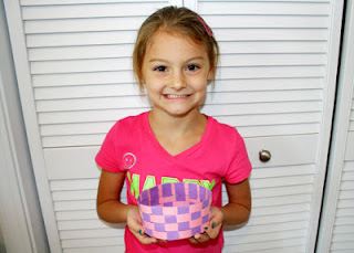 After folding in the top of the arms and then gluing them down, Tessa's African basket was finally complete! I'm really proud of her. Tessa diligently worked on her basket for over an hour and completed the vast majority of it by herself. She asked questions about how ancient people weaved baskets throughout the project. Afterward, she commented that she really liked weaving and couldn't believe she made her very own basket.