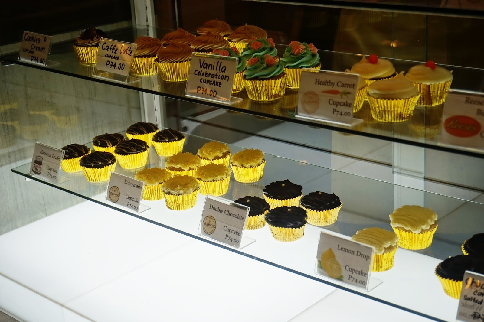 my little buttercup bakery and cafe's cupcakes display