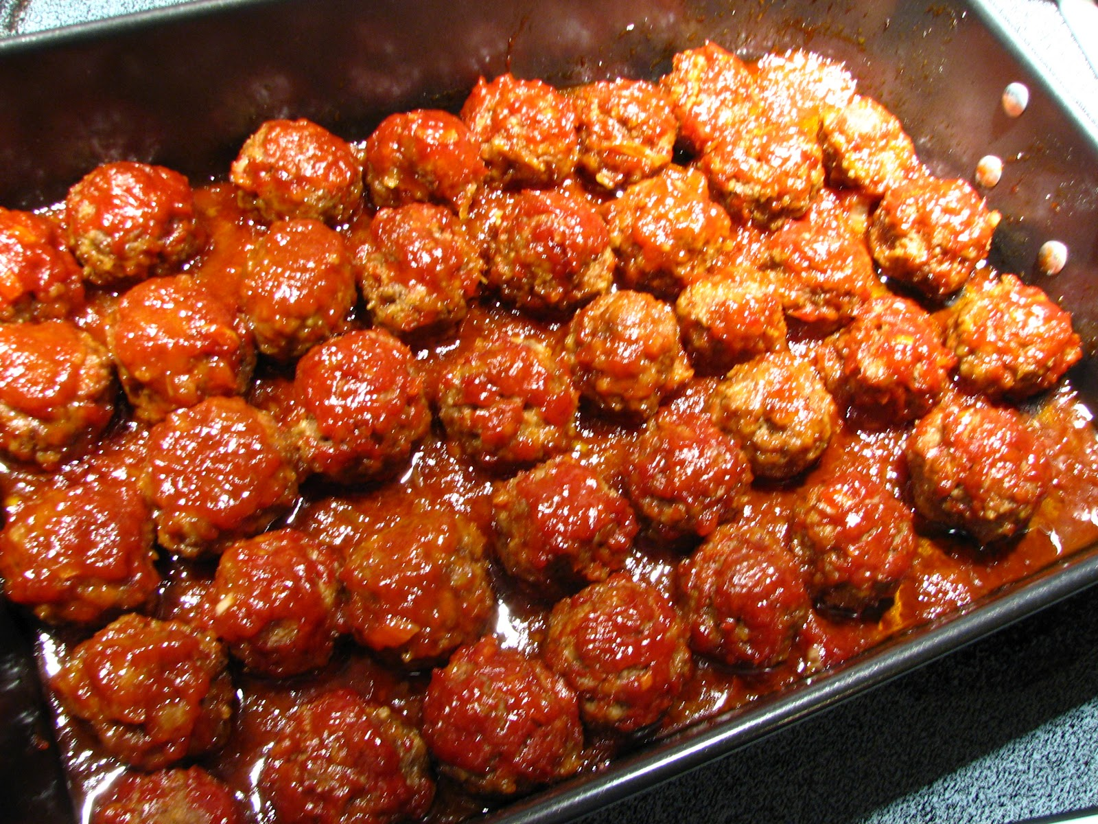 Baked Barbecued Meatballs will make your home smell wonderful. Just ...