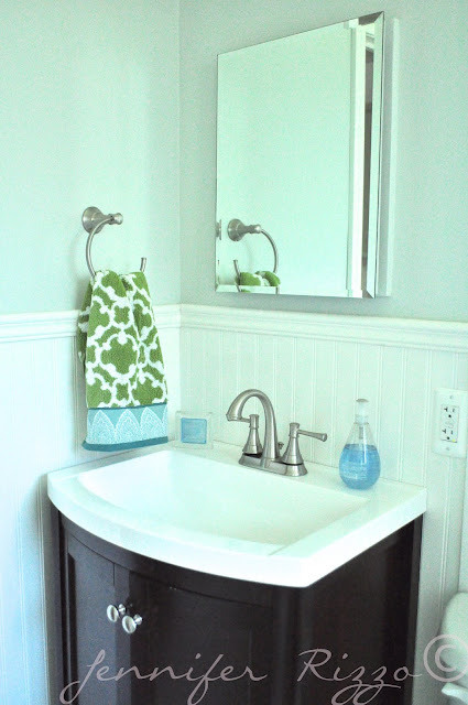 The Oak house project full bathroom renovation with a dark vanity  and moen faucets