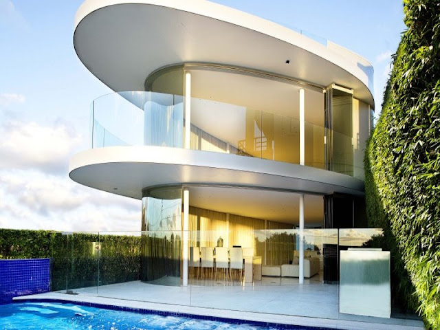 Modern house and the swimming pool with glass fence