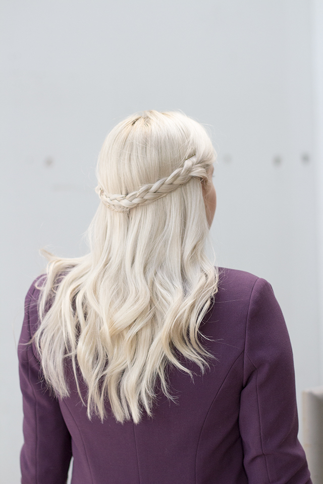 Braided half crown on platinum blonde hair.