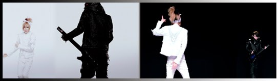 Maya  dances facing front, while Aiji plays guitar with his back to the camera against a white backdrop / Maya dances with his back to the camera while Aiji plays guitar facing front in front of a black backdrop.