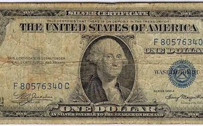 Srebrni dolar denar z realno vrednostjo.