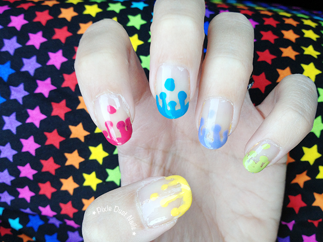 Paint drip nail art to match a Paint the Night inspired outfit
