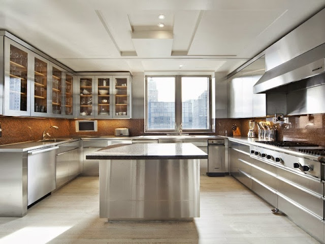 State of the art chef's kitchen with sleek stainless steel cabinets