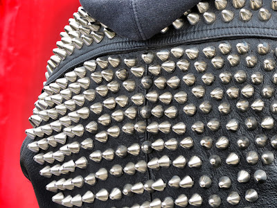 1234 Shoreditch Detail of studs on leather jacket