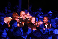 A group enjoys a performance together