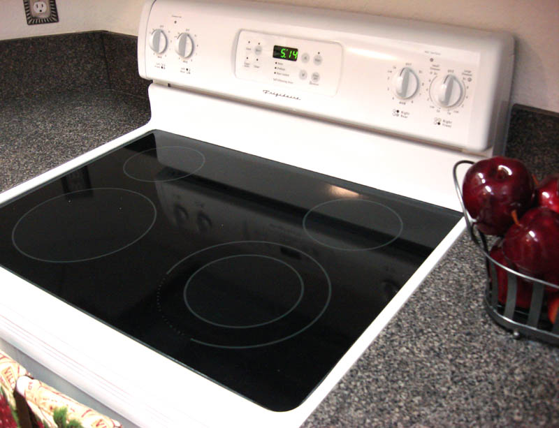 how to clean burnt water off glass stove top