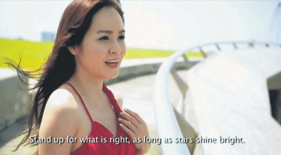 A screen grab of the music video for Shine Singapore, composed and performed by singer-songwriter Lorraine Tan.
