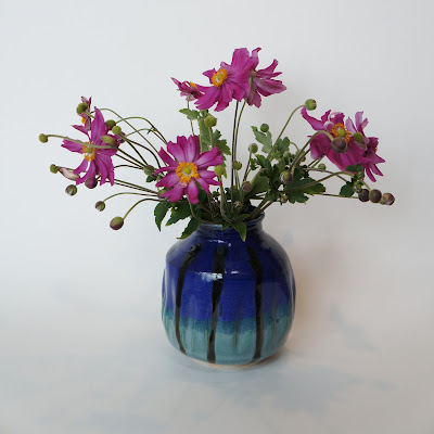 Beautiful ceramic pottery vase with flowers by Lily.