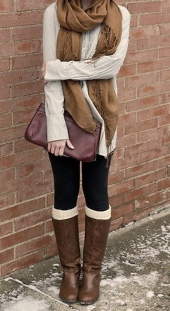 Brown scarf, cream sweater shirt, leggings with long boots