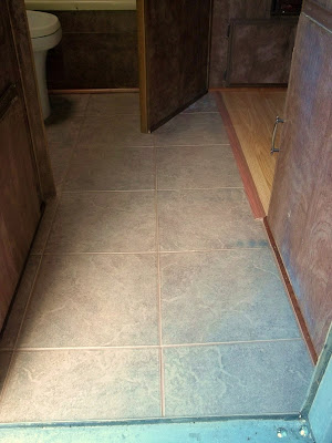 Porcelain tile fixes rotten floor in our 1980 Shasta camp trailer