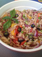 Easy Orzo Salad served family style in a large, deep bowl.