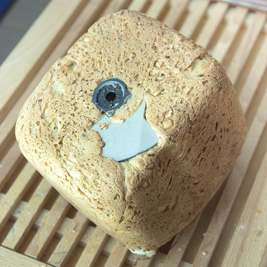 Bread with bread macine mixing blade stuck inside.