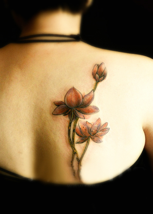 red lotus flower tattoo on the back