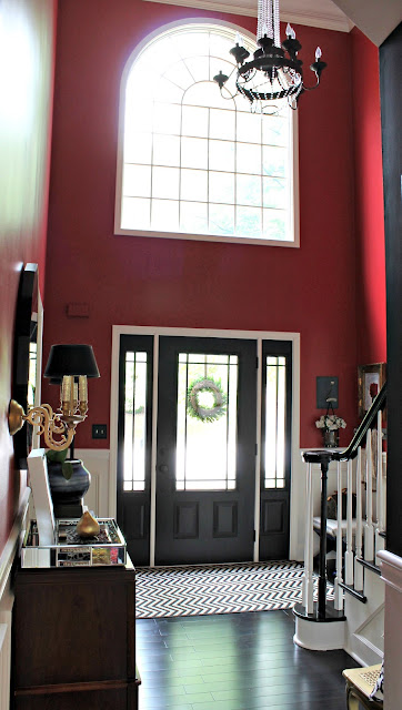 dark wood floors and black doors