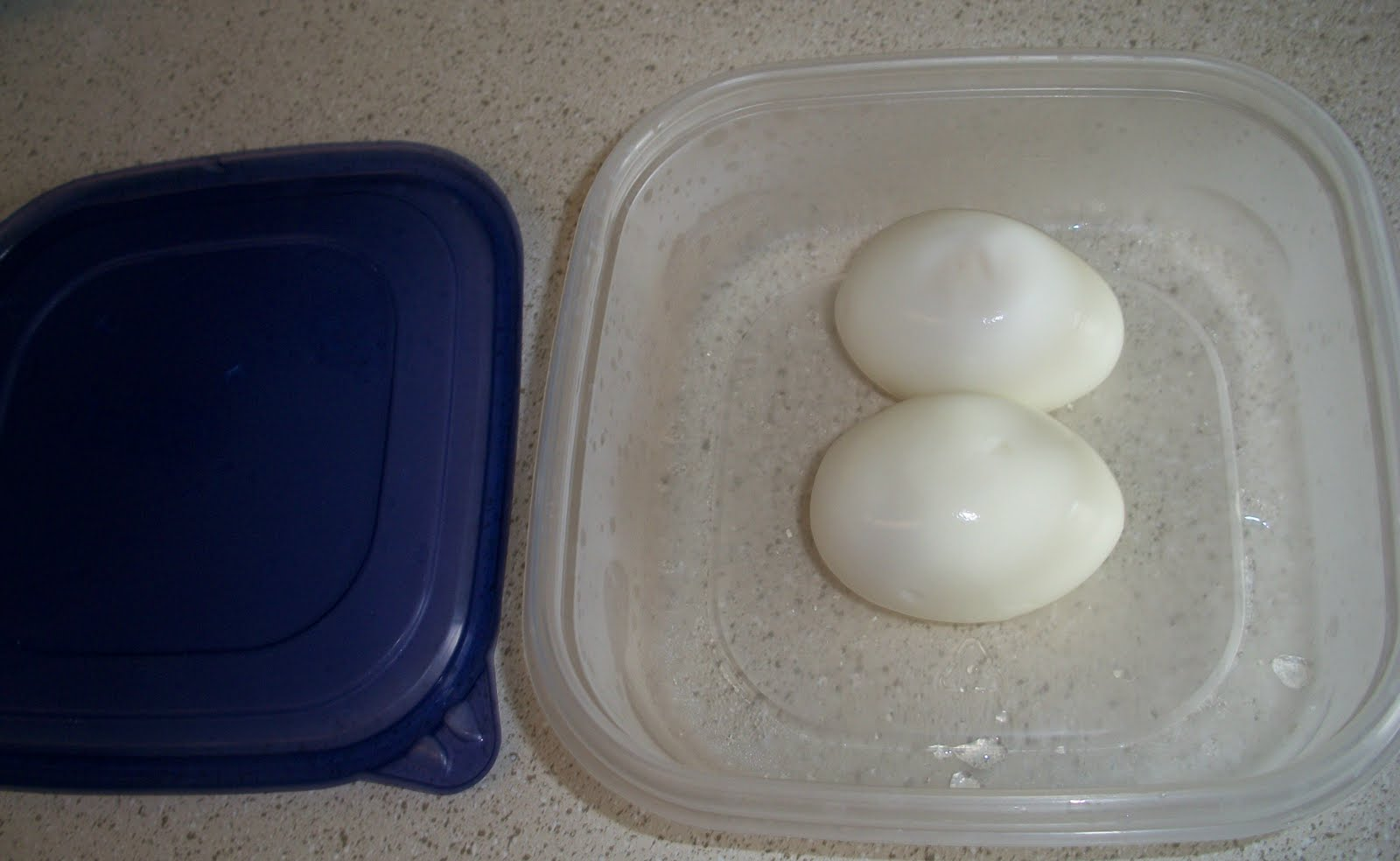 Peeled eggs in an airtight container