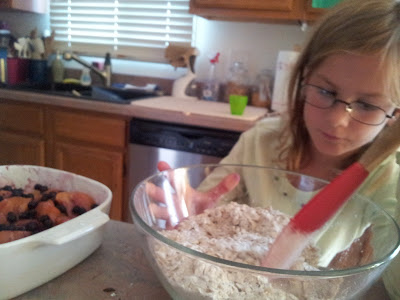 Little Miss stirring the topping for the Peach Blueberry Crisp