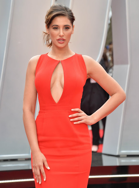 "Nargis Fakhri risks a wardrobe malfunction In Red Dress At ""Spy"" UK Premiere At Odeon Leicester Square"