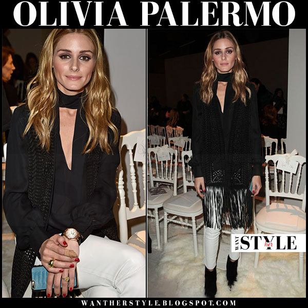 Olivia Palermo in black fringed cardigan, black blouse and white leather pants front row what she wore