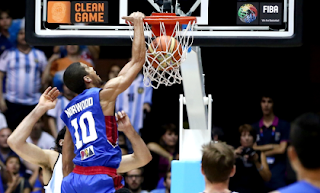 Norwood Dunks Over Argentinians