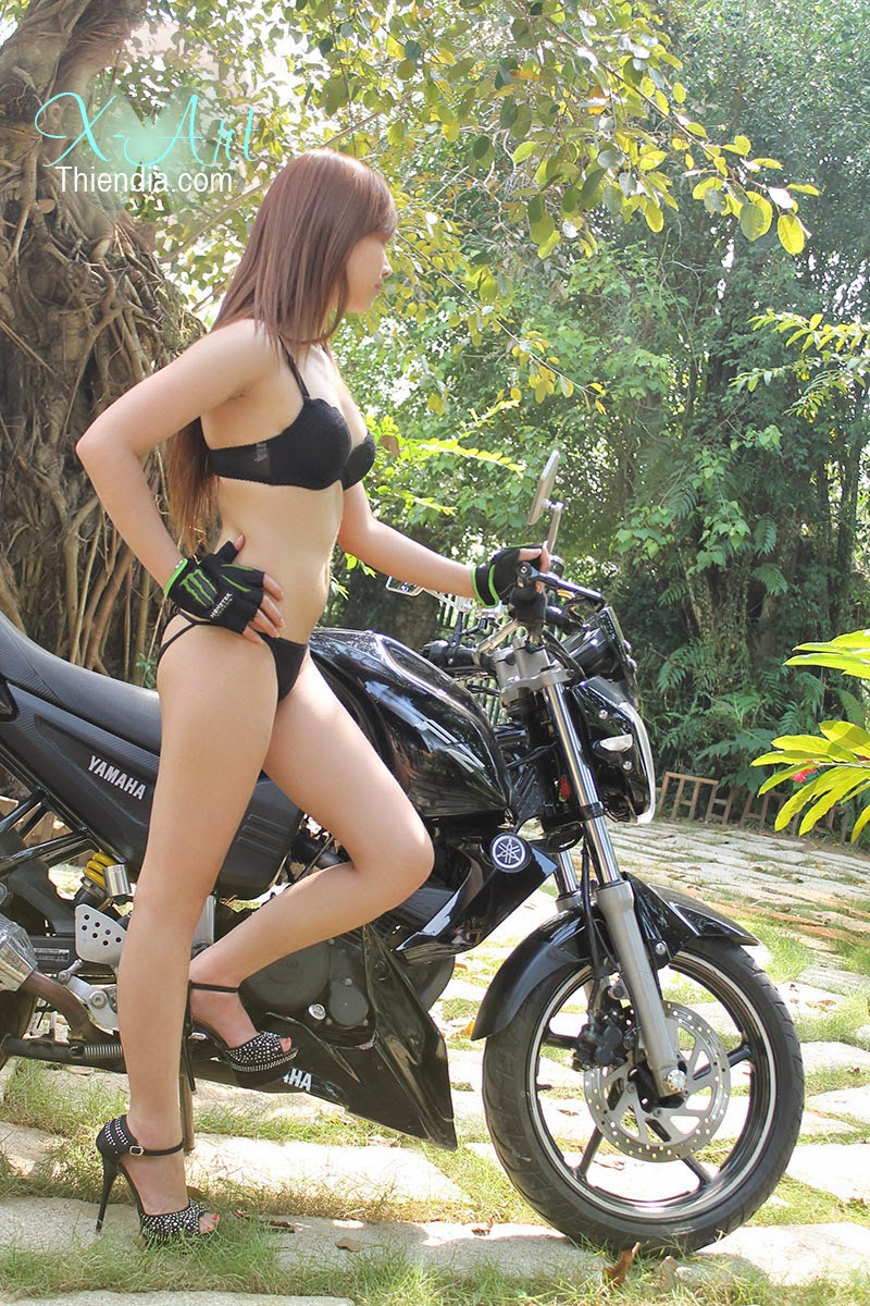 Girl beautiful and super motorcycle