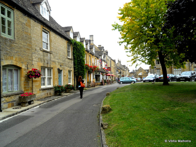 Stow-on-the-Wold, Last stop in Cotswolds,Stow-on-the-wold was the last stop in Cotswolds and this was a bad decision on the part of the organizers because after the pastel prettiness of Bourton on the Water, Stow-on-the-Wold appeared pretty average. Historically, it is a market town that was situated at the convergence of many important roads. And even today, the main part of the town is the market. We only had 45 mins here and, therefore, not much time to explore. Though we had run out of things to do already after this time. The Market Square at the centre of the town. There were several cafes, antique shops and souvenir shops around the square and at the centre was the St Edward's Hall. Also, this was the only town where we didn't have anything to eat or drink. The time was too short. Hannah, our scamperer, is in a hurry to get to the next antique shop. While Kelsey McTexty and myself strolled behind. One of the modern looking streets leading into the market square. The street was totally out of character when compared to the visual appeal of rest of the town.The other side of the St. Edward's Hall. The Hall now houses the public library.This was the last stop in Cotswolds during our trip. However, there was one more stop and it was Shakespeare's Straford Upon Avon. Watch out for the next post.To read the previous posts in this series, click here: Bourton on the Water. Stow-on-the-Wold, UK, Cotswolds, St Edward's Hall, England