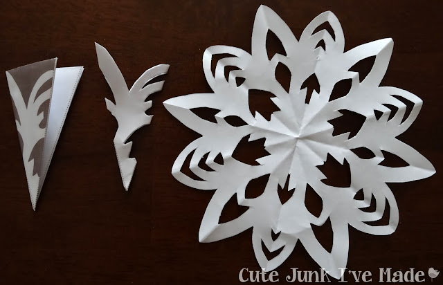 Paper Snowflake Curtain Tutorial - Template 4 folded, cut out and final product