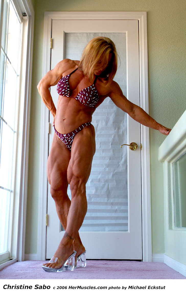 Christine Sabo Flexing Her Ripped, Muscular Legs In Heels And A Bikini