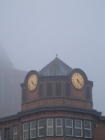 Double Townclock shrouded in fog