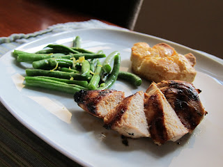 Marinated, grilled chicken served with steamed green beans and buttermilk biscuits