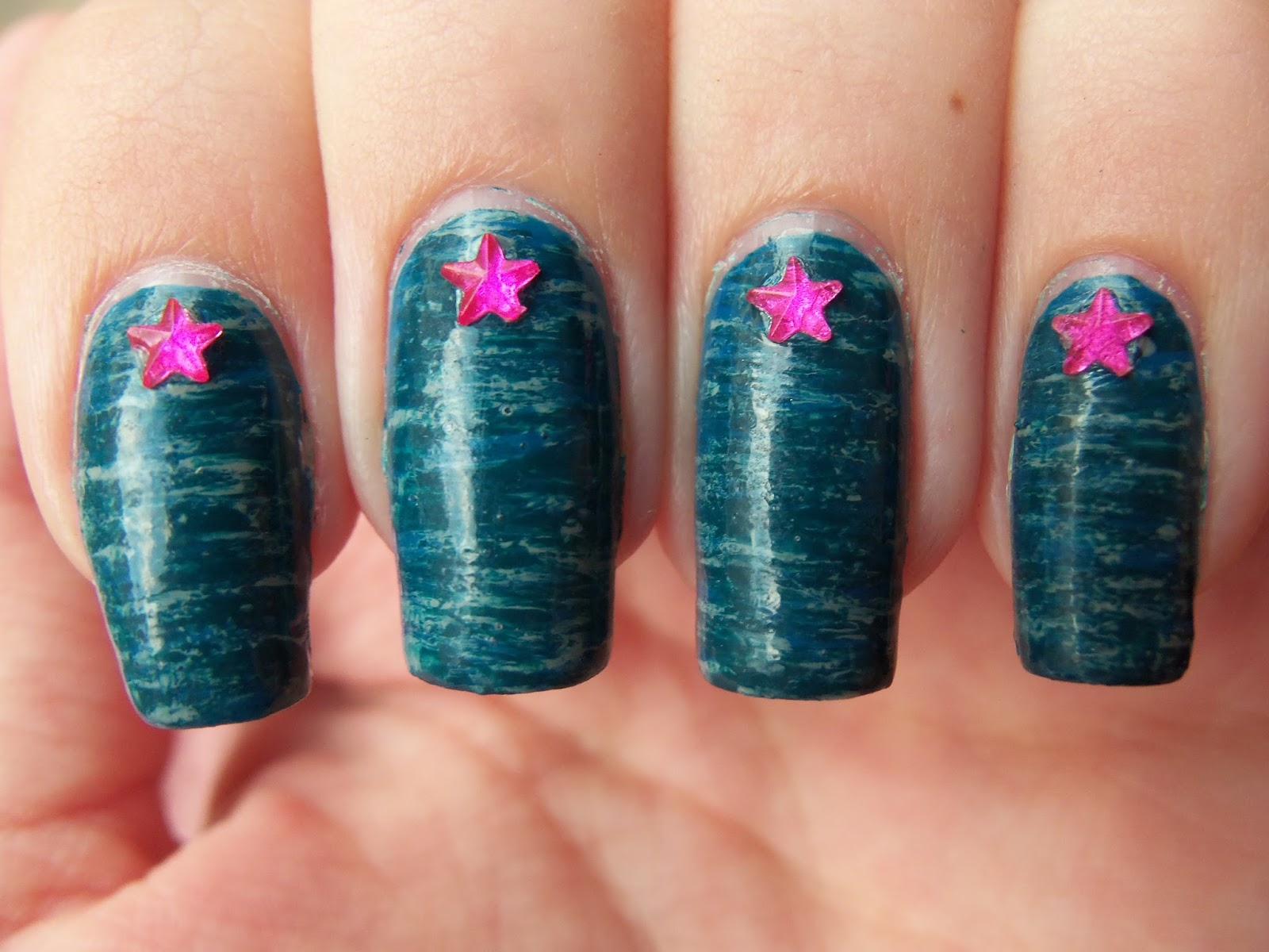 http://megsmanicures.blogspot.com/2014/07/star-gems-on-fan-brushed-stripes.html