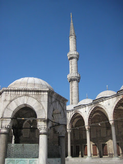 The courtyard and a minaret of the Blue Mosque.