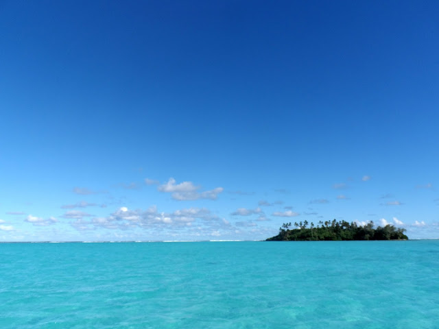 small island in clear blue sea off Rarotonga