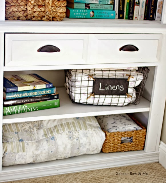 Linen storage on open shelves in bedroom via www.goldenboyandme.com