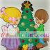 Niños con árbol de navidad.