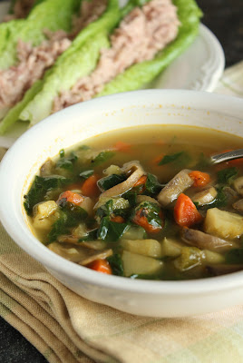 vitamin vegetable soup with carrots, parsnips, celery, mushrooms and spinach