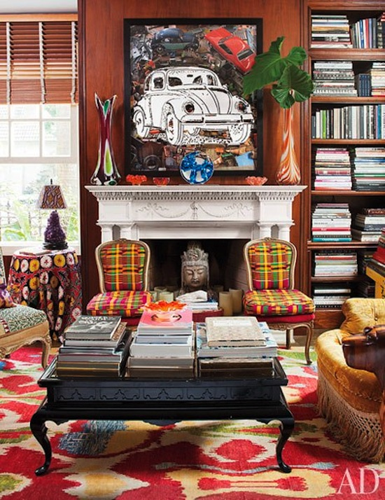 bright prints, carpet, colors, art, books, statues