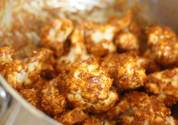 cauliflower coated with tandoori seasoning and almond butter mixture