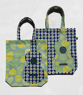 Lemon and daisy print bags