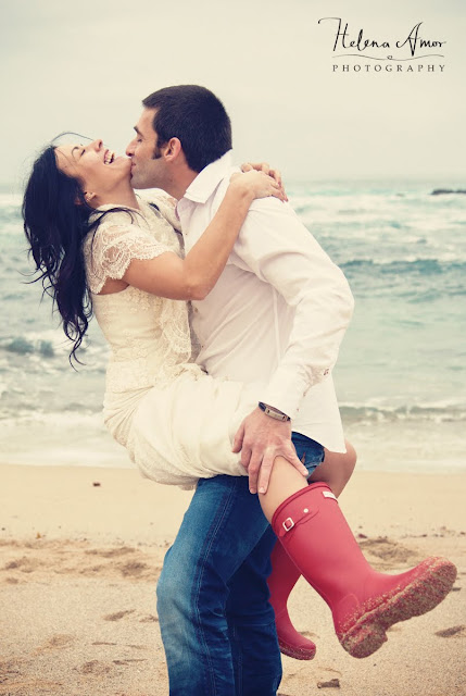 playful bride and groom at the beach
