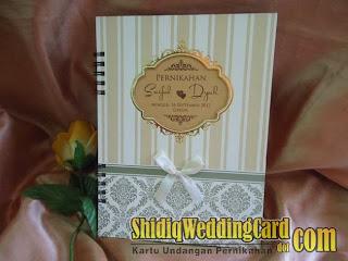 http://www.shidiqweddingcard.com/2013/11/hardcover-harco-sdk-souvenir-buku_7.html