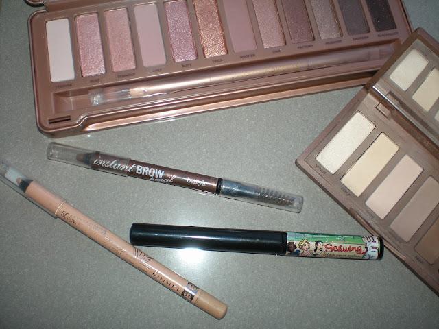 Urban Decay Naked 3 and Naked Basics palettes, Rimmel London ScandalEyes Kajal Eyeliner, TheBalm Schwing Liquid Eyeliner, Benefit Instant Brow pencil
