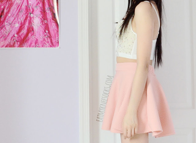 Side view of the beaded cream-colored bustier top from SheIn and a pastel-pink skater skirt.