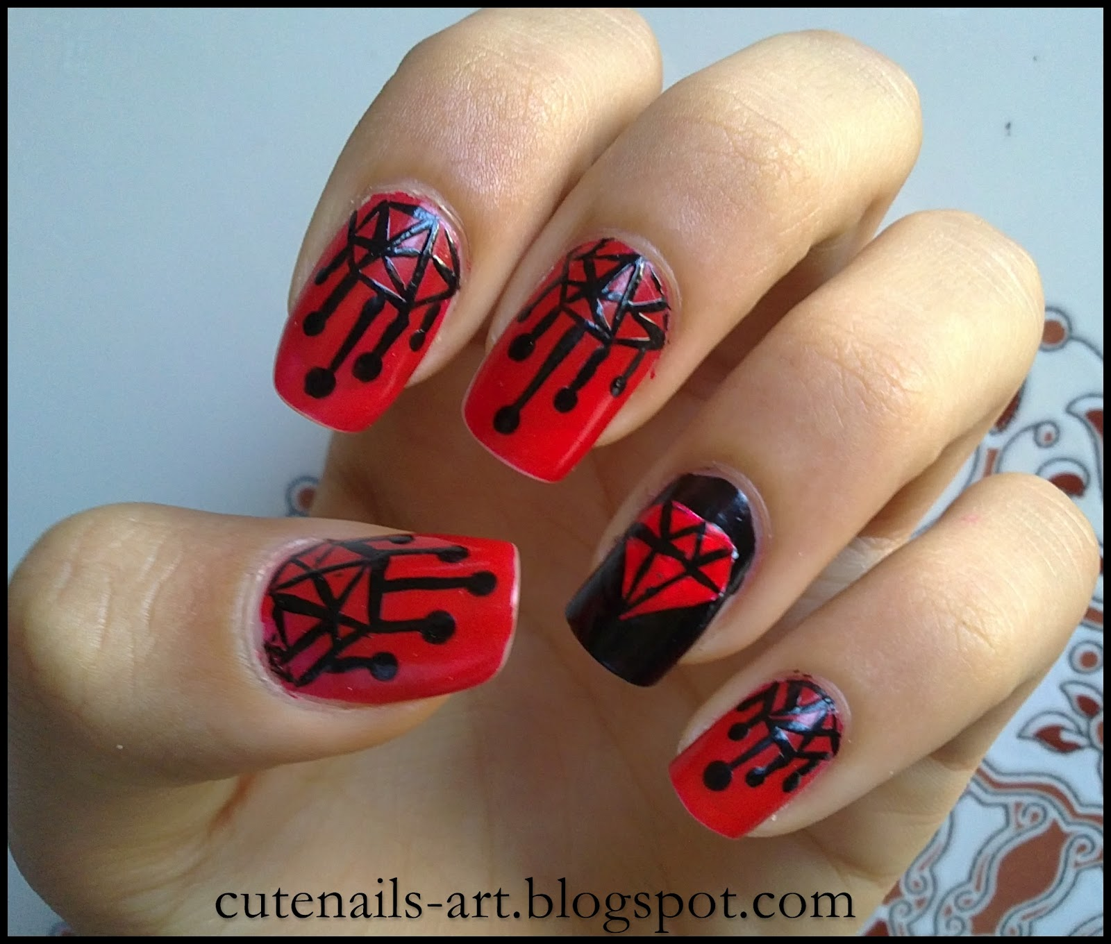 name this nail art as a black chandeliers red diamond nail art design