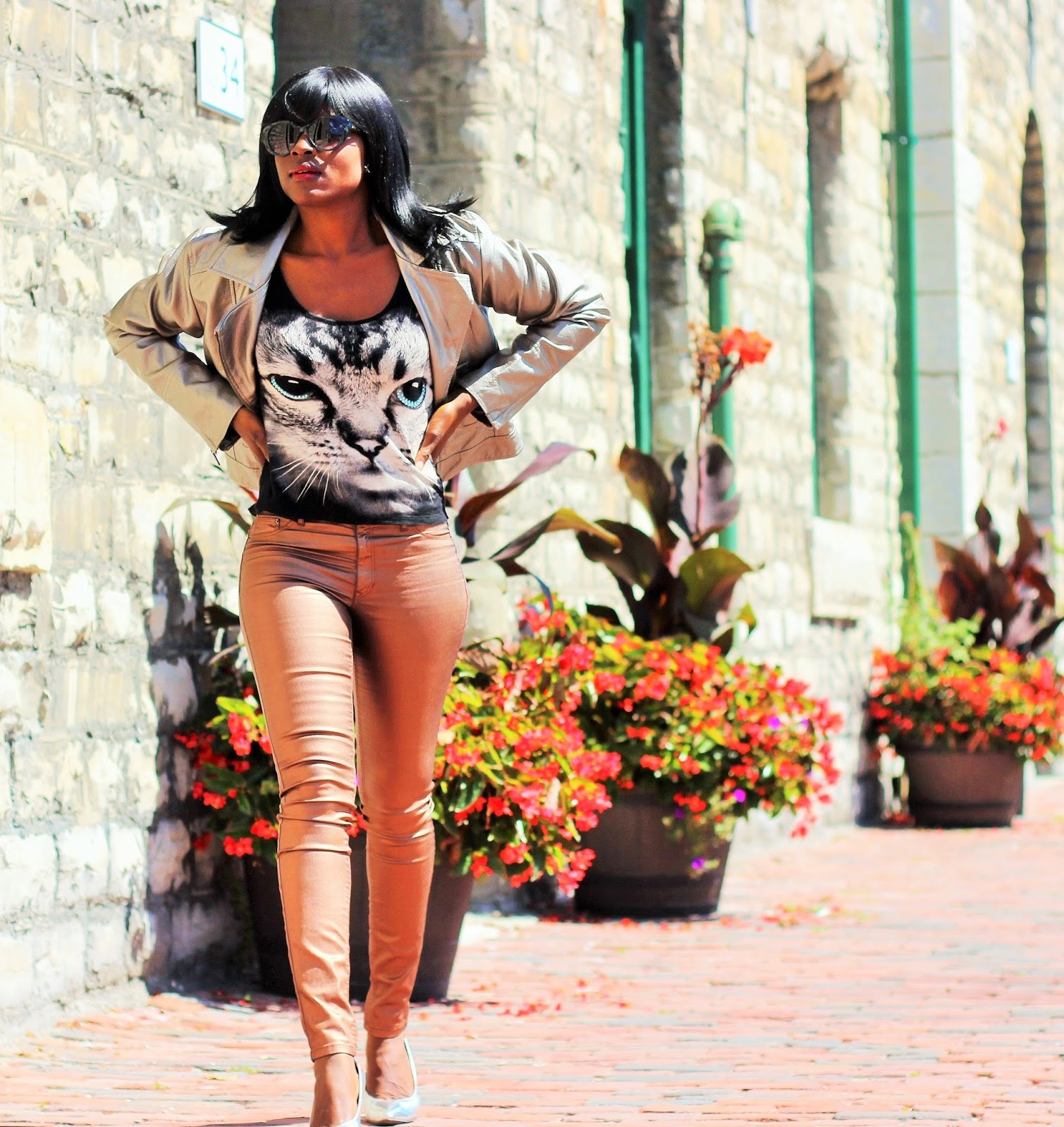 Metallic Gold Jacket Styled With Metallic Gold Pants & A Graphic Top