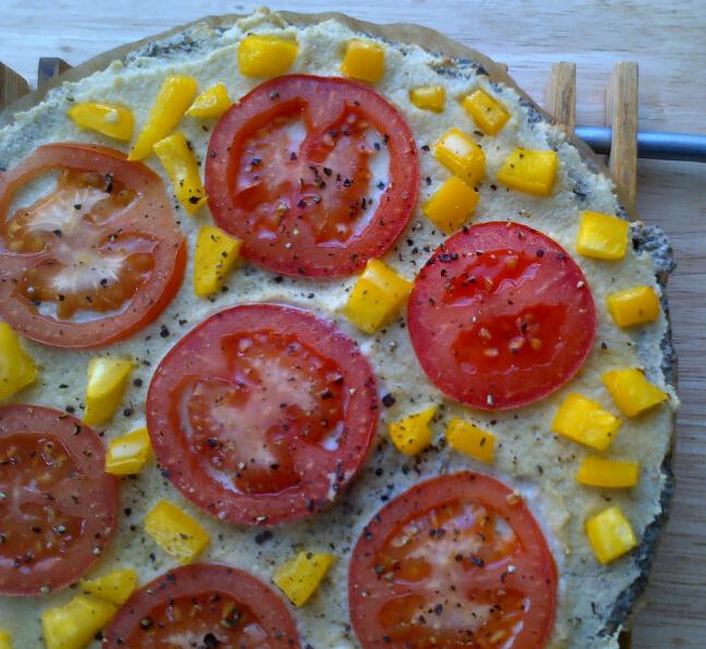 cashew cream cheese, tomato & yellow pepper pizza on regina's grain-free chia buckwheat pizza crust
