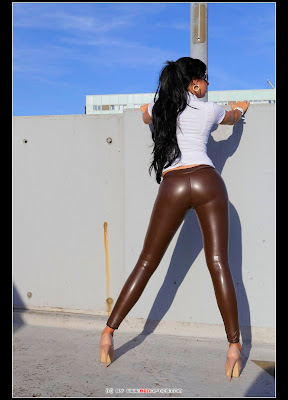 Stella Van Gent Posing in Tight Latex Pants and Heels