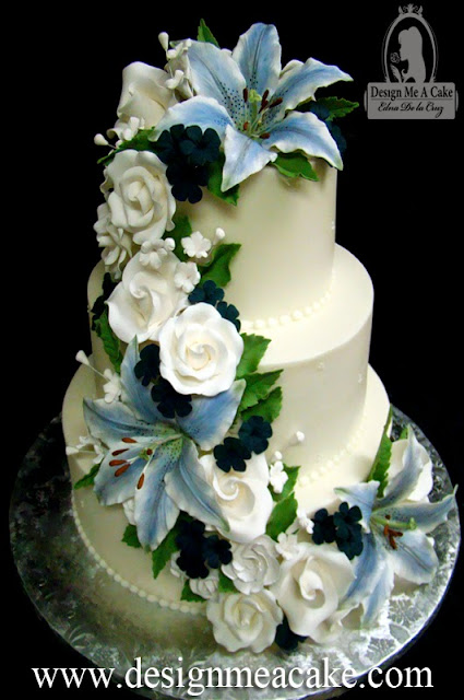 Wedding cake with blue Stargazer lilies and other gumpaste flowers.
